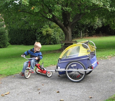 Pulling the bike trailer with his trike.